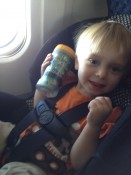 Ashton on the airplane flying to TX