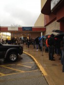 People waiting in the rain to get into the Fat Kid movie...