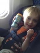 Ashton on the airplane flying to TX