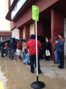 People waiting in the rain to see the movie!